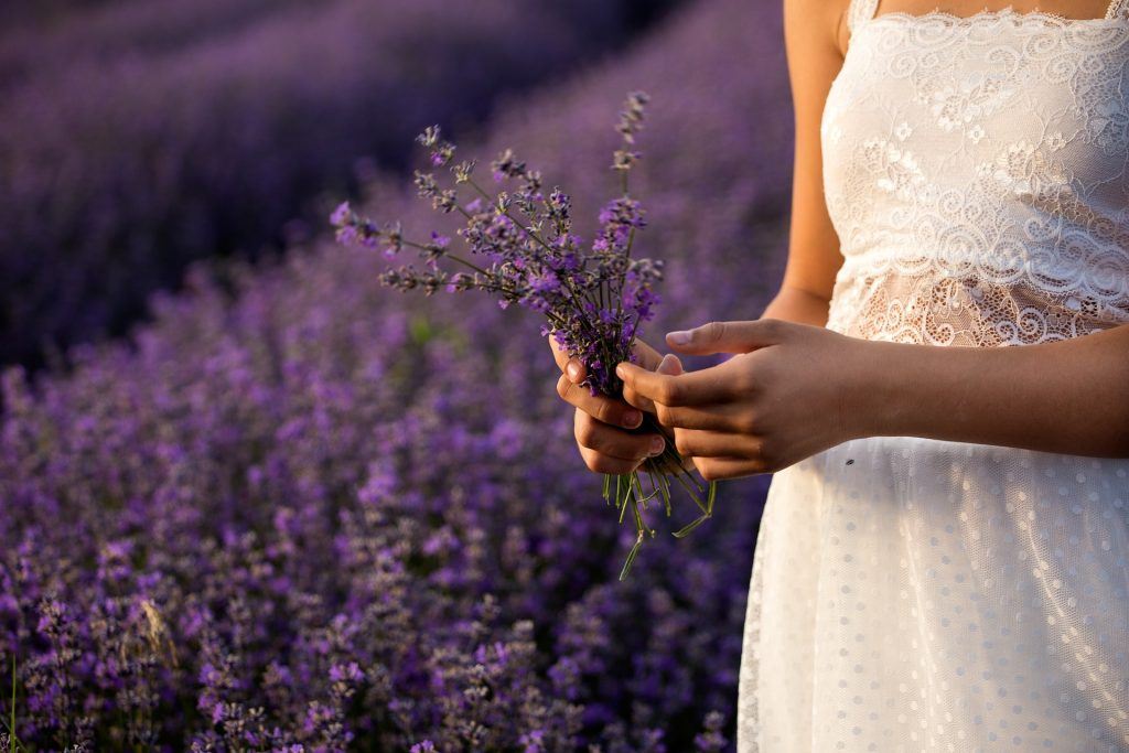 girl holding lavender - how i get a good nights sleep