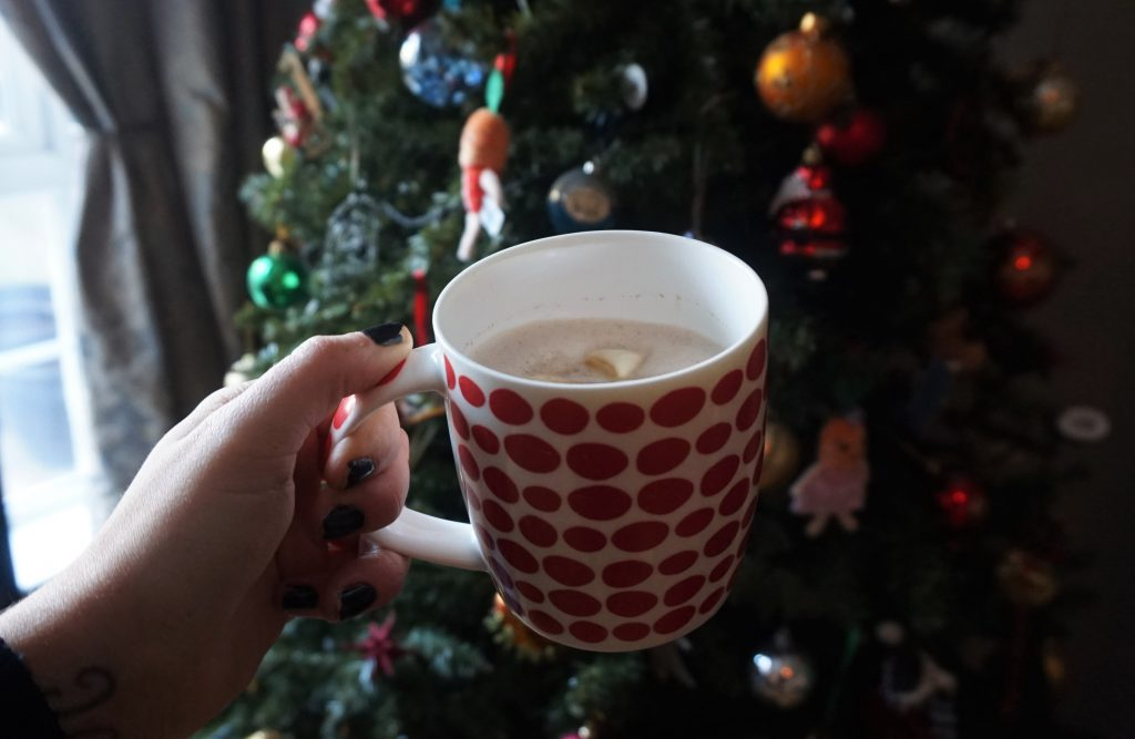 home made vegan gingerbread latte in front of Christmas tree